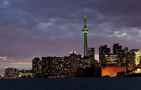 The CN Tower is lit in green and white colours to commemorate Franco Ontario Day in Toronto on Tuesday, September 25, 2012. THE CANADIAN PRESS/Michelle Siu
